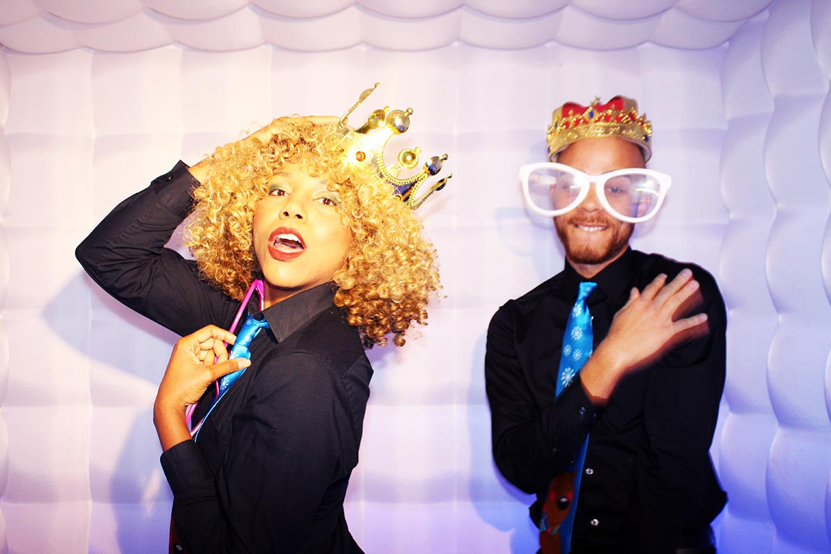 king and queen posing in the photo booth