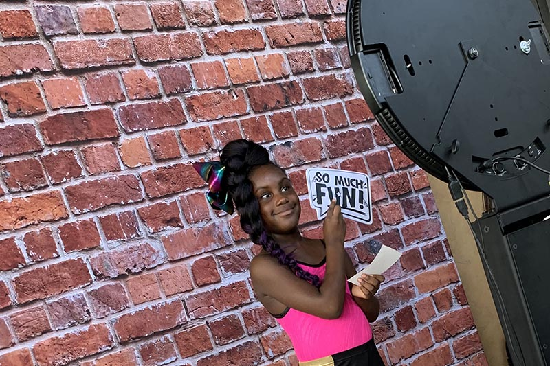 girl posing in the Houston open-air photo booth